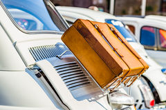 Leather suitcase on luggage rack. Of ancient Italian subcompact white car Royalty Free Stock Photo