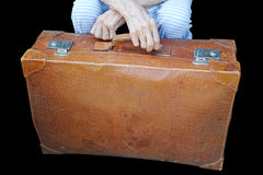 Leather suitcase and old woman& x27;s hands. Leather suitcase and old woman& x27;s hands isolated on black background Stock Photography