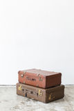 Leather suitcase on white wall. Royalty Free Stock Image