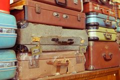 Leather suitcases stacked. Vintage old battered leather suitcases stacked Royalty Free Stock Photography