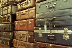 Leather suitcases stacked. Vintage old battered leather suitcases stacked Stock Images