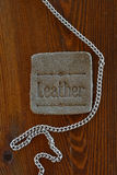 Leather tag and chain Stock Photography