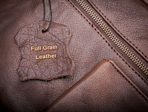 Leather Tag. With Full Grain Leather text embossed in gold Stock Photo