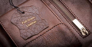 Leather Tag. With Full Grain Leather text embossed in gold Royalty Free Stock Photo