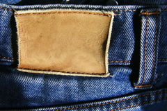 Leather tag of jeans Stock Photos