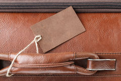 Leather tag on leather travel case Stock Images