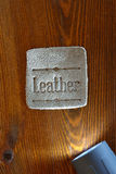 Leather tag and spotlight Stock Photo