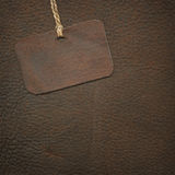 Leather tag on suede Stock Images