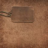 Leather tag on suede Stock Image