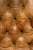 Leather texture. Soft brown leather texture on the back of old chair royalty free stock photography