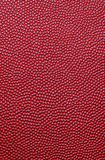 Leather texture. A background of maroon pebble-grained leather stock image