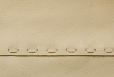 Leather texture. Background of light leather with stitches Royalty Free Stock Image