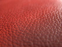 Leather texture. Closeup of a red leather texture stock photos