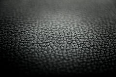 Leather Texture. Black leather texture detail with shallow depth of field royalty free stock photo