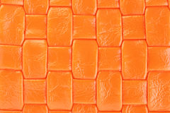 Leather. Texture colorful orange leather woven background Stock Photography