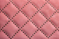 Leather texture with metal rivets. Use as background stock images