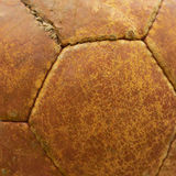Leather texture of an old football ball. Leather texture of an old football ball, closeup shot Royalty Free Stock Image