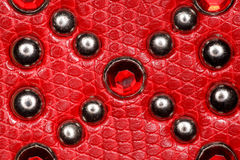 Leather texture with rivets and precious stones Royalty Free Stock Photo