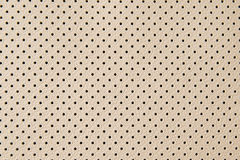 Leather texture with small black holes Royalty Free Stock Photo