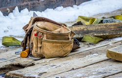 Leather Tool Belt on a Wooden Trailer Stock Images