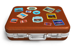 Leather travel suitcase with labels. Brown leather travel suitcase with colorful labels isolated on white background royalty free illustration