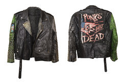 Leather underground punk stylish jacket with rivets and with Punks not dead slogan on a back stock photos