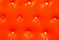 Leather upholstery. Red orange the leather upholstery Stock Images
