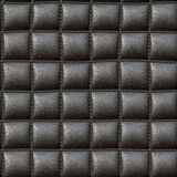 Leather upholstery. Background and texture of stretched old black leather Stock Photo