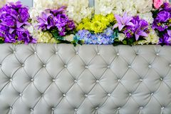 Leather upholstery and flowers background stock image