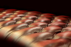 Leather upholstery of furniture. The brown-red upholstery leather pattern background Stock Photography