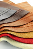 Leather upholstery samples. Natural leather upholstery samples with stitching in various colors Royalty Free Stock Photo