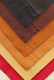 Leather upholstery samples. Natural leather upholstery samples with stitching in various colors Royalty Free Stock Photos
