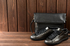 Leather upper metallic womens shoes and black leather bag on bro Royalty Free Stock Image