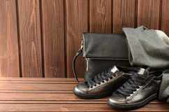 Leather upper metallic womens shoes, scarf and black leather bag Royalty Free Stock Photography