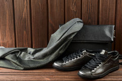 Leather upper metallic womens shoes, scarf and black leather bag Royalty Free Stock Images