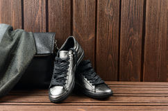 Leather upper metallic womens shoes, scarf and black leather bag Stock Photography