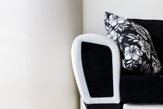 Leather with velvet sofa against a white wall Royalty Free Stock Photography