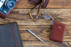 Leather vintage Items and Photo camera on Wood Background Royalty Free Stock Photos