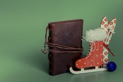 Leather vintage notebook with entourage for Christmas. skiing skates stock image