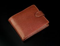 Leather wallet. Brown leather wallet on a black background Stock Image