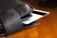 Leather wallet. Black leather wallet on a Brown background Royalty Free Stock Photo