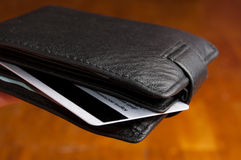 Leather wallet. Black leather wallet on a Brown background Stock Photography