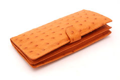 Ostrich leather wallet on white. A big brown ostrich leather wallet. Image isolated on white studio background Royalty Free Stock Images