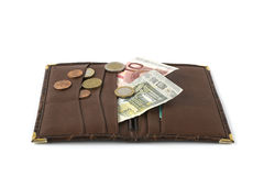 Leather wallet with banknotes and coins. Opened leather wallet with some euro banknotes and coins isolated on white stock photos