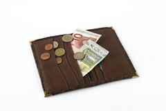 Leather wallet with banknotes and coins Stock Photos