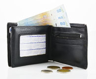 Leather wallet and banknotes on a white background Royalty Free Stock Images