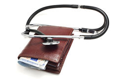 A leather wallet being examined with a stethoscope stock photos
