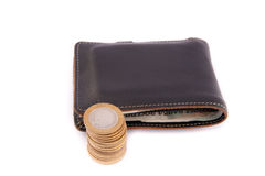 Leather wallet and coins Stock Photo