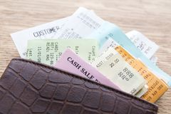 Leather Wallet Containing Receipts Stock Photos