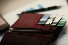 Leather wallet with credit in discount cards Royalty Free Stock Photos